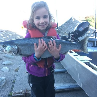 Sarah Tessaro holds a 10 1/4 lb coho caught by her father Mark on Sunday in Oak Bay
