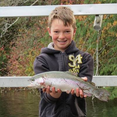 Coltin Richardson with a nice rainbow trout that he caught at Langford Lake